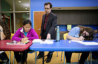 NWA Democrat-Gazette/DAVID GOTTSCHALK  Arie Kaplan (center), writer and cartoonist, speaks with Xiying Fan (left), 12, and Emily Shirkey, 12, during a workshop Monday, April 17, 2017, on how to draw magazine-style gag cartoons at the Fayetteville Public Library. The lesson focused on using basic shapes, improvisation and creative brainstorming. Kaplan will be speaking for a second night on Jews and the history of Comic Books in America tonight at the University of Arkansas at 7:00 p.m. at the G. David Gearhart Hall on the campus.
