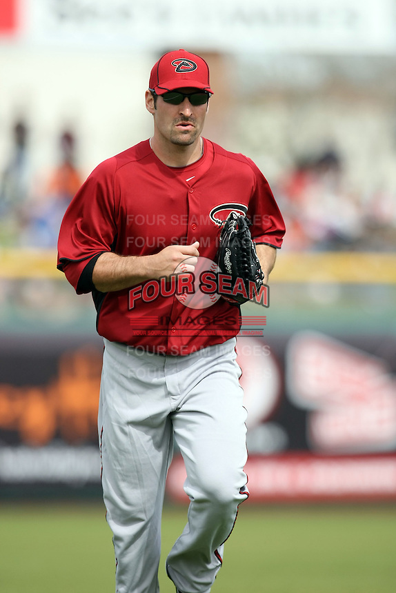 Xavier Nady #22 of the Arizona Diamondbacks comes in from the outfield in the game against the San Francisco Giants in the first spring training game of the season at Scottsdale Stadium on February 25, 2011  in Scottsdale, Arizona. .Photo by:  Bill Mitchell/Four Seam Images.