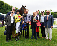 All connections of Beringer in the winners enclosure after winning The Bathwick Tyres EBF Novice Stakes,during Ladies Evening Racing at Salisbury Racecourse on 15th July 2017