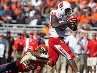 Ball State running back Jahwan Edwards (32) runs past Virginia cornerback DreQuan Hoskey (22) for a 4th quarter touchdown during the football game Saturday Oct. 5, 2013 at Scott Stadium in Charlottesville, VA. Ball State defeated Virginia 48-27. Photo/The Daily Progress/Andrew Shurtleff