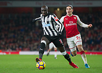 Mohamed Diamé of Newcastle United and Héctor Bellerín of Arsenal during the Premier League match between Arsenal and Newcastle United at the Emirates Stadium, London, England on 16 December 2017. Photo by Vince  Mignott / PRiME Media Images.