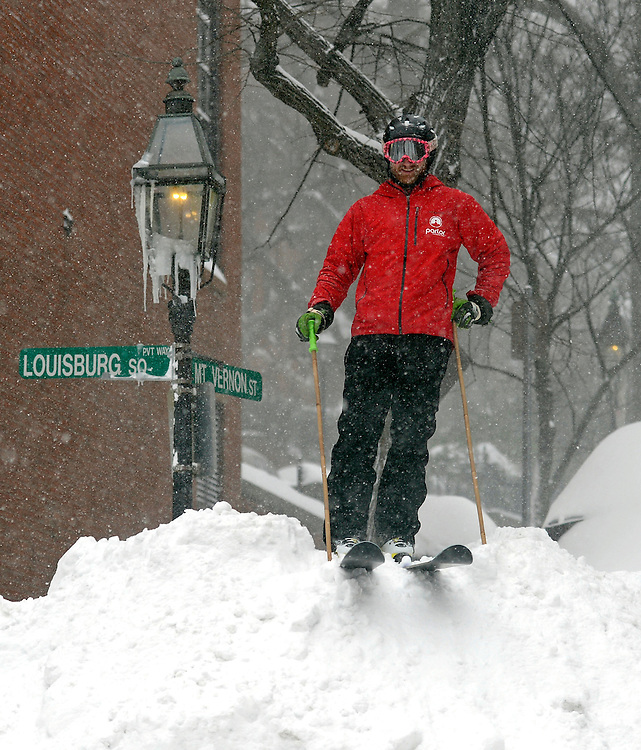 Boston resident Mark Wallace prepares ski down a snow bank in Boston's Beacon Hill neighborhood after a blizzard dumped over two feet of snow in the city on Tuesday, January 27, 2015. Photo by Christopher Evans