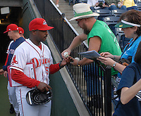 Manager Billy McMillon (51) of the Greenville Drive, Class A affiliate of the Boston Red Sox, signs autographs prior to a game against the Augusta GreenJackets on April 7, 2011, at Fluor Field at the West End in Greenville, S.C. Photo by Tom Priddy / Four Seam Images