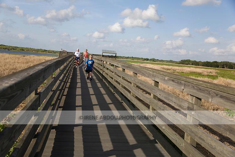 A birdwalk in Myakka River State Park in Sarasota, Florida leads into Upper Myakka Lake.