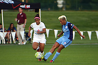 Kansas City, MO - Saturday May 28, 2016: Orlando Pride midfielder Lianne Sanderson (10) kicks the ball as FC Kansas City midfielder Desiree Scott (3) defends. FC Kansas City defeated Orlando Pride 2-0 during a regular season National Women's Soccer League (NWSL) match at Swope Soccer Village.