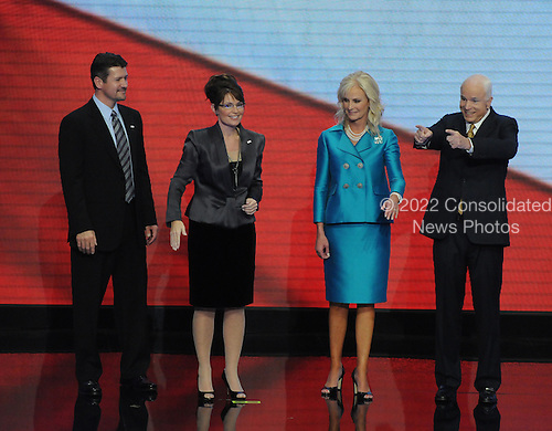 St. Paul, MN - September 4, 2008 -- United States Senator John McCain (Republican of Arizona), right, points to the crowd after accepting his party's nomination as President of the United States on day 4 of the 2008 Republican National Convention at the Xcel Energy Center in St. Paul, Minnesota on Thursday, September 4, 2008.  From left to right: Todd Palin, Governor Sarah Palin of Alaska, Cindy McCain, John McCain.Credit: Ron Sachs / CNP.(RESTRICTION: NO New York or New Jersey Newspapers or newspapers within a 75 mile radius of New York City)