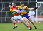 Donncha O Connor of Cork in action against Jamie Malone of Clare during their National Football League game at Cusack Park. Photograph by John Kelly.