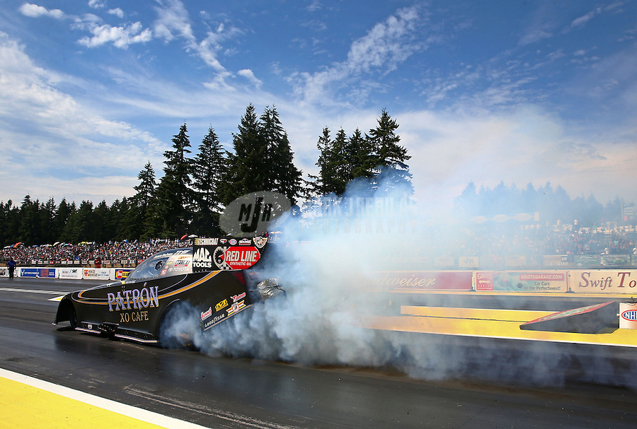 Aug. 1, 2014; Kent, WA, USA; NHRA funny car driver Alexis DeJoria during qualifying for the Northwest Nationals at Pacific Raceways. Mandatory Credit: Mark J. Rebilas-USA TODAY Sports