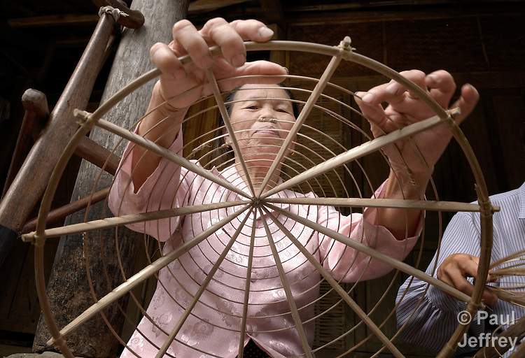 Nguyen Thi Duong, who lost her right leg to a landmine, is a member of a cooperative of people with disabilities in Bo Trach, Vietnam, that produces conical hats. .