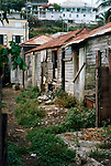 Old wooden abandoned shacks with corrugated tin roofs. Caribbean circa 1976