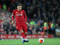 24th February 2020; Anfield, Liverpool, Merseyside, England; English Premier League Football, Liverpool versus West Ham United; Roberto Firmino of Liverpool plays a pass as Liverpool attack