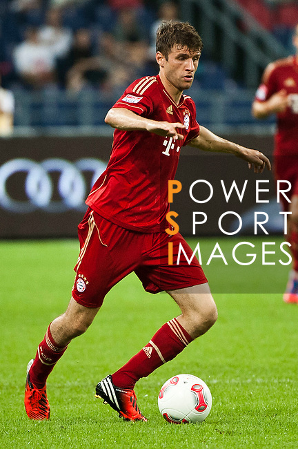 GUANGZHOU, GUANGDONG - JULY 26:  Thomas Muller of Bayern Munich in action during a friendly match against VfL Wolfsburg as part of the Audi Football Summit 2012 on July 26, 2012 at the Guangdong Olympic Sports Center in Guangzhou, China. Photo by Victor Fraile / The Power of Sport Images