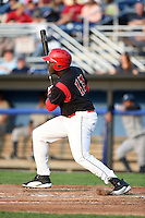 Batavia Muckdogs outfielder K.J. Woods (13) at bat during a game against the Staten Island Yankees on August 6, 2014 at Dwyer Stadium in Batavia, New York.  Batavia defeated Staten Island 5-3.  (Mike Janes/Four Seam Images)