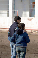 South America, Argentina, La Plata, Los Olmos. Freedom Behind Bars, Prison and Divinity - Family visiting inmates of Unit 25 of Los Olmos Prison. Los Olmos Prison is one of the principal security prisons in Argentina. It hosts Unit 25, also known as Christ the Only Hope Prison Church, one of the largest prison churches worldwide. The transformation of criminals into the God fearing and leading them to the Lord has taken hold, not only in the lives of inmates, but also in inmate families and prison guards. Once the countries worst killers and thieves have since become spiritual leaders to other criminals, creating a revolutionary spiritual rehabilitation, July 2006 &copy; Stephen Blake Farrington<br />