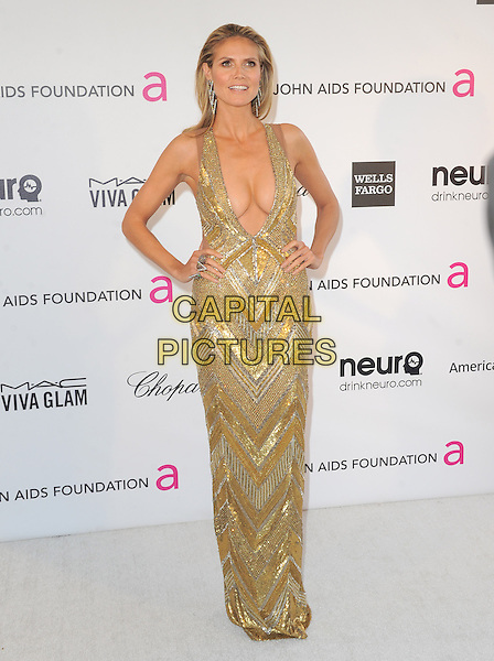 Heidi Klum (wearing Julien Macdonald).The 21st Annual Elton John AIDS Foundation Academy Awards Viewing Party held at The City of West Hollywood Park in West Hollywood, California, USA..February 24th, 2013.oscars full length gold diamante sequins sequined dress beads beaded art deco plunging neckline cleavage hands on hips.CAP/DVS.©DVS/Capital Pictures.