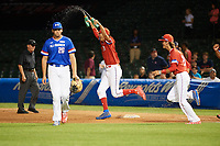 Ethan Hankins (31) of Forsyth Central High School in Cumming, Georgia runs on the field - followed by Blaze Alexander (21) of Bishop Verot High School in Cape Coral, Florida - to celebrate a walk off victory as first baseman Triston Casas (26) of American Heritage High School in Pembroke Pines, Florida walks off the field during the Under Armour All-American Game presented by Baseball Factory on July 29, 2017 at Wrigley Field in Chicago, Illinois.  (Mike Janes/Four Seam Images)