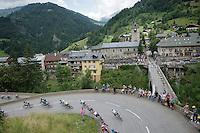 peloton entering the village of Flumet<br /> <br /> Stage 20: Megève › Morzine (146.5km)<br /> 103rd Tour de France 2016