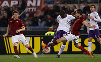 Calcio, Europa League: Ritorno degli ottavi di finale Roma vs Fiorentina. Roma, stadio Olimpico, 19 marzo 2015.<br /> Fiorentina's Khouma el Babacar, center, is challenged by Roma's Kostas Manolas, right, and Adem Ljajic, during the Europa League round of 16 second leg football match between Roma and Fiorentina at Rome's Olympic stadium, 19 March 2015.<br /> UPDATE IMAGES PRESS/Isabella Bonotto