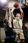 SIOUX FALLS, SD - MARCH 10:  Kyle Steigenga #32 from Cornerstone shoots over Stephen Turner #22 from St. Francis during their quarterfinal game at the 2018 NAIA DII Men's Basketball Championship at the Sanford Pentagon in Sioux Falls. (Photo by Dick Carlson/Inertia)