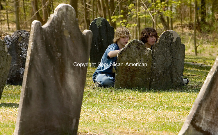 SHARON, CT- 26 APRIL 2008 --042608JS17-B.J. Shapiro-Albert, 13, left and Kaelan Paton, 15, right, cleans off  grave stones in Hillside Cemetery in Sharon on Saturday. The clean up and restoration project was part of a program by the Sharon Historical Society. <br /> Jim Shannon / Republican-American