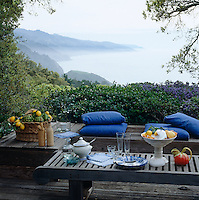 The dramatic coastline provides an idyllic backdrop for simple outdoor dining