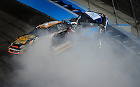 Apr 10, 2008; Avondale, AZ, USA; NASCAR Camping World Series West drivers Greg Pursley (70) Jim Warn (10) and Eric Hardin (5) crash during the Jimmie Johnson Foundation 150 at Phoenix International Raceway. Mandatory Credit: Mark J. Rebilas-