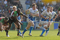 Tom Heathcote of Bath Rugby outruns Ugo Monye of Harlequins as Dan Hipkiss of Bath Rugby shouts encouragement during the Aviva Premiership match between Harlequins and Bath Rugby at The Twickenham Stoop on Saturday 24th March 2012 (Photo by Rob Munro)