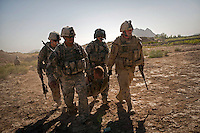 US Army soldiers carry a soldier wounded in an IED (improvised explosive device) blast onto a Charlie Company, Sixth Battalion, 101st Aviation Regiment medevac helicopter near Kandahar.