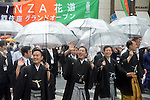 March 27, 2013, Tokyo, Japan - Ichikawa Ukon, left, and Ichikawa Monnosuke walk with some 60 leading Kabuki actors in the rain through the main street of Tokyo's Ginza shopping district on Wednesday, March 27, 2013, in celebration of the grand opening of new Kabuki theater. After three years of renovation, the majestic theater for Japan's centuries-old performing arts of Kabuki will open its doors to the public with a three-month series of most sought-after plays.  (Photo by Natsuki Sakai/AFLO)