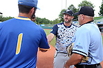 31 May 2016: Nova Southeastern head coach Greg Brown (center) shakes the hand of Lander head coach Kermit Smith (1) as home plate umpire Darryn Fredrickson (right) watches. The Nova Southeastern University Sharks played the Lander University Bearcats in Game 8 of the 2016 NCAA Division II College World Series  at Coleman Field at the USA Baseball National Training Complex in Cary, North Carolina. Nova Southeastern won the game 12-1.