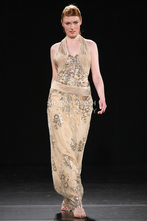 Model walks runway in a Hadi Katra outfit, during Couture Fashion Week Fall 2011.