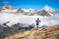 Trail running above Zermatt, Switzerland with views of the 4000 meter peaks above town.