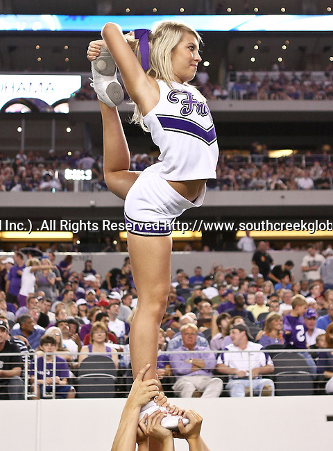 TCU cheerleaders during the game between the Oregon State Beavers and the TCU Horned Frogs at the Cowboy Stadium in Arlington,Texas. TCU defeated Oregon State 30-21.