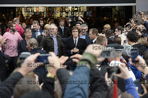 SIR PAUL MCCARTNEY - traffic is brought to a halt as Paul McCartney is mobbed by crowds as he leaves the HMV store after signing copies of his 'NEW' Album at HMV Oxford Street London UK - 18 Oct 2013.  Photo credit: George Chin/IconicPix