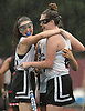 Micaela FitzPatrick #23 of North Shore, right, gets congratulated by Maggie Gibbons #16 and teammates after scoring her second goal against Friends Academy in the second half of a rain-filled Nassau County League 3 varsity field hockey game at North Shore High School in Glen Head on Thursday, Oct. 11, 2018. North Shore won by a score of 3-1. (Note to editor: The 'P' in the primary subject's last name is capitalized.)