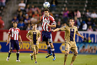CD Chivas USA midfielder Jonathan Bornstein (13) heads a ball away from Philadelphia Union's Sebastien Le Toux (9). The Philadelphia Union and CD Chivas USA played to 1-1 draw at Home Depot Center stadium in Carson, California on Saturday evening July 3, 2010..