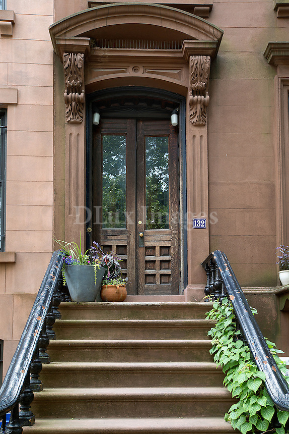 brownstone facade<br /> <br /> Artist Suzanne McClelland works and lives with her talented family in an 1874 five floor brownstone in the historic Clinton Hill area in Brooklyn, New York.