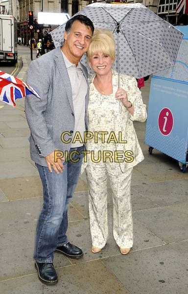 LONDON, ENGLAND - AUGUST 05: Barbara Windsor MBE and husband Scott Mitchell attend a photocall as Team London ambassadors welcome visitors from around the World on August 5, 2015 in London, England. <br /> CAP/PP <br /> &copy;PP/Capital Pictures