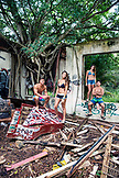 USA, Oahu, Hawaii, portrait of MMA Mixed Martial Arts Ultimate fighter Lowen Tynanes, Logan Garcia, Tyson Tynanes and Kyla Tipps in an abandoned building on the North Shore of Oahu