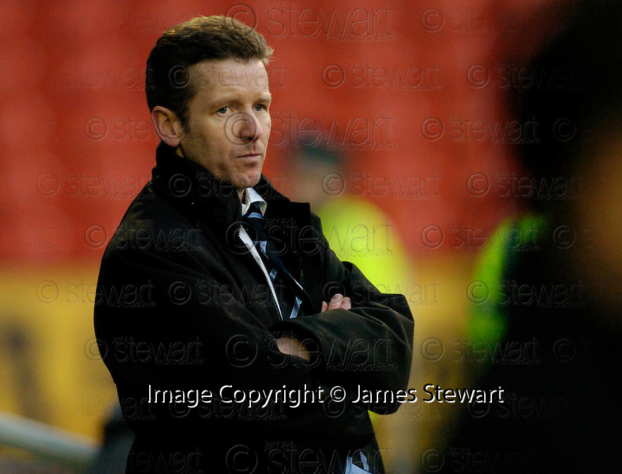 18/02/2006         Copyright Pic: James Stewart.File Name : sct_jspa25_dundee_utd_v_inverness.CHARLIE CHRISTIE WATCHES HIS TEAM COME BACK TO BEAT DUNDEE UTD.Payments to :.James Stewart Photo Agency 19 Carronlea Drive, Falkirk. FK2 8DN      Vat Reg No. 607 6932 25.Office     : +44 (0)1324 570906     .Mobile   : +44 (0)7721 416997.Fax         : +44 (0)1324 570906.E-mail  :  jim@jspa.co.uk.If you require further information then contact Jim Stewart on any of the numbers above.........