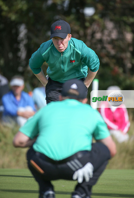 Gavin Moynihan (IRL)  gives Jack Hume (IRL) the line on the 12th during Sunday morning Foursome matches of The Walker Cup 2015 played at Royal Lytham and St Anne's, Lytham St Anne's, Lancashire, England. 13/09/2015. Picture: Golffile | David Lloyd<br /> <br /> All photos usage must carry mandatory copyright credit (&copy; Golffile | David Lloyd)
