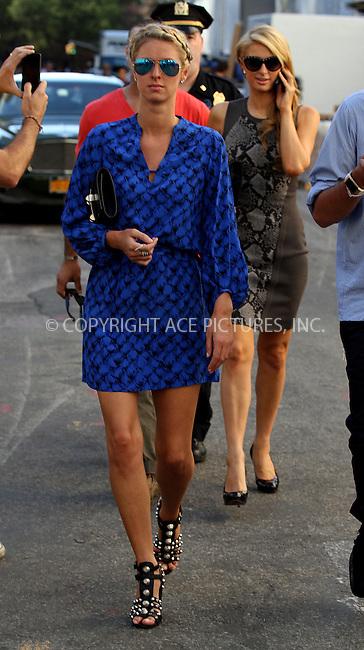 WWW.ACEPIXS.COM<br /> <br /> September 8 2013, New York City<br /> <br /> Paris Hilton (R) and Nicky Hilton arrive at Mercedes-Benz New York Fashion Week on September 8 2013 in New York City<br /> <br /> By Line: Zelig Shaul/ACE Pictures<br /> <br /> <br /> ACE Pictures, Inc.<br /> tel: 646 769 0430<br /> Email: info@acepixs.com<br /> www.acepixs.com