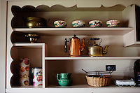 "Wellsville, Kansas, May 28, 2011 - A view of the cupboards at the guest house of fourth generation family farmer Robin Dunn at her farm, Dunn's Landing. The guest house was the home Dunn grew up in since age three. She says that most of the antoques in the home belonged to her family. ""I purchased a lot of these at my grandmother's estate sale,"" said Dunn. ..Dunn bought her great grandparents homestead from her father in 1993, and today grows soybeans, corn, sorghum and hay, and maintains a small herd of Black Angus cattle and eight horses which she uses to for wagon and stage coach rides.  According to the most recent Department of Agriculture data, there are more than 306,000 farms run primarily by women in 2007, representing about 14 percent out of the 3.3 million American farms.  That's up from 237,819 or 11 percent in 2002, and a big increase from the 1980s when about five percent of U.S. farms were operated by women.Dunn has branched out from her farming business, using her century-old dairy barn to host 25 to 30 weddings and other events a year. She also attracts tourists for farm tours and carriage rides, and holds sessions with school children to teach them about faming."