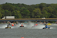 Sam Miller, (#7) leads the field out of the first turn.  (SST-60)
