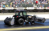 Jul. 26, 2014; Sonoma, CA, USA; NHRA Safety Safari member driving a tractor preparing the track for qualifying for the Sonoma Nationals at Sonoma Raceway. Mandatory Credit: Mark J. Rebilas-