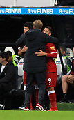 1st October 2017, St James Park, Newcastle upon Tyne, England; EPL Premier League football, Newcastle United versus Liverpool; Dominic Solanke and Roberto Firmino get a hug from Jurgen Klopp Manager of Liverpool before going on as subs in the 1-1 draw