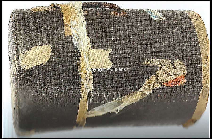 BNPS.co.uk (01202 558833)Pic: Juliens/BNPS<br /> <br /> Mitchell's Hendrix Experience travel trunk. Stenciled 'EXP'.<br /> <br /> An enormous collection of items belonging to the late drummer Mitch Mitchell has emerged for sale.<br /> <br /> The star, who died at the age of 67 in 2008, was best known for his work with Jimmy Hendrix Experience between 1966 and 1970.<br /> <br /> Now his family have decided to sell a large amount of his personal items as they feel they can no longer handle the responsibility and want to see them go to a good home.<br /> <br /> The collection is made up of countless instruments, shirts, posters and documents - many of which are previously unseen.<br /> <br /> The items offer a gateway to a different time with some incredibly outlandish and psychedelic lots perfectly encapsulating London in the 60s.<br /> <br /> Among them is a multi coloured, patchwork shaggy coat which Mitchell would often wear to parties.<br /> <br /> The coat hangs below the waist and looks more like a rug from Austin Powers front room than a sophisticated dinner jacket.