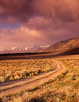 Steens Mountains with road and clouds. Oregon.