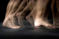 Feet walking.  A special stroboscopic camera records the motion.  The record of the motion can be analyzed to show both the timing and range of the motion.  This type of image is very important in the science of biomechanics.