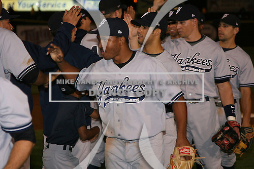 September 4, 2009:  Freddy Guzman of the Scranton Wilkes-Barre Yankees followed by Reegie Corona after a game at Frontier Field in Rochester, NY.  Scranton is the Triple-A International League affiliate of the New York Yankees and clinched the North Division Title with a victory over Rochester.  Photo By Mike Janes/Four Seam Images